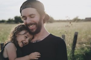 Smiling Dad with Daughter